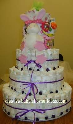 purple roses and bunny diaper cake