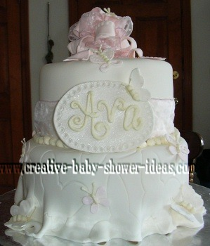 white fondant butterfly cake with a sign that says Ava
