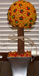 candy corn topiary bouquet with cinnamon sticks