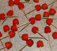 toothpicks pushed into pumpkin mellowcreme candy