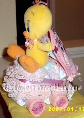 pink tweety bird baby carriage diaper cake