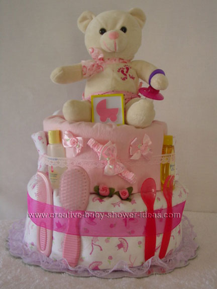 cream and pink teddy bear carriage diaper cake