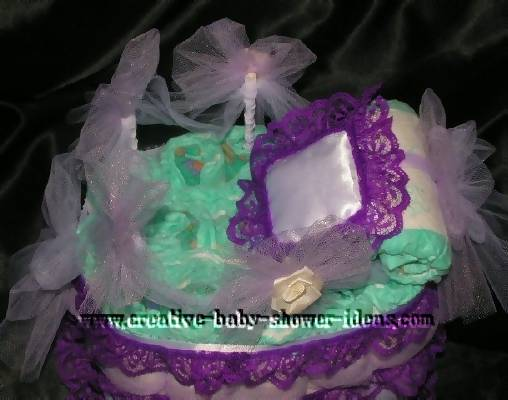 top of bassinet diaper cake showing pillow