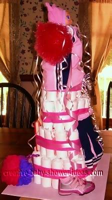 side of cheerleading diaper cake with cheer sneakers