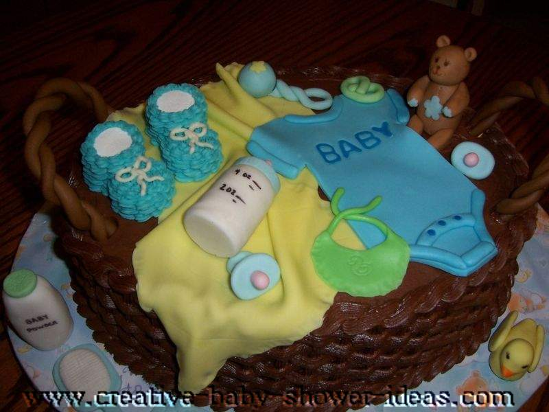 chocolate basket baby shower cake with baby clothes