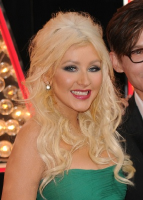 smiling christina aguilera wearing teal dress