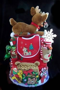 side of christmas diaper cake showing bib and baby clothing