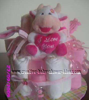 pink and white cow diaper cake with I love you heart