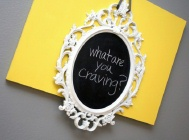 white chalkboard sign on yellow canvas that says pregnancy cravings