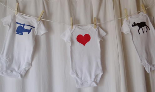 baby shower clothesline with cute onesies