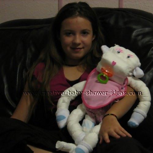 smiling girl holding monkey diaper animal