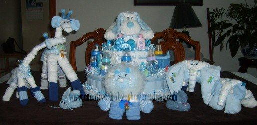 blue and white diaper cakes and animals