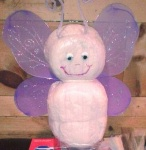 purple and white diaper butterfly