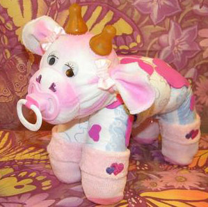 pink and white diaper cow
