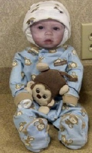 diaper baby in blue monkey pajamas and baby photo face