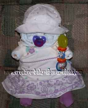 diaper baby in purple flowers dress