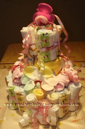 pink and yellow teether diaper baby cake