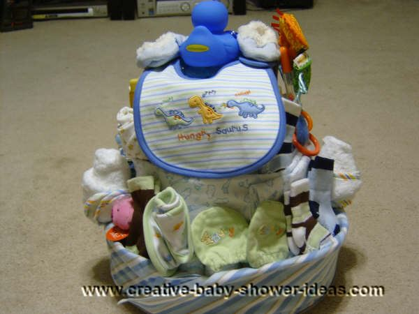 back of duck diaper cake that shows a bib with hungry saurus on it