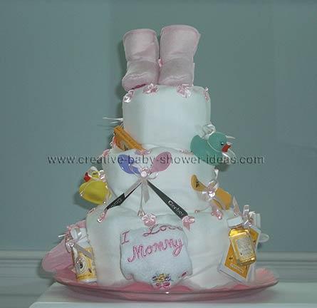 pink bootie diaper baby cake