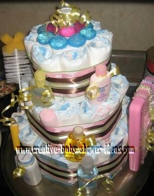 top view of mod diaper cake with baby supplies