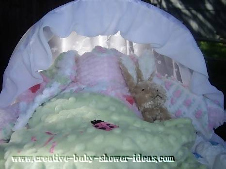 closeup of bunny rabit sleeping insed diaper bassinet cake