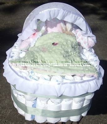 green and white diaper bassinet cake