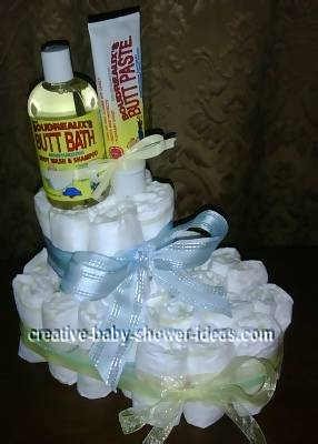 white diaper bootie with yellow and blue ribbons and bath supplies on top