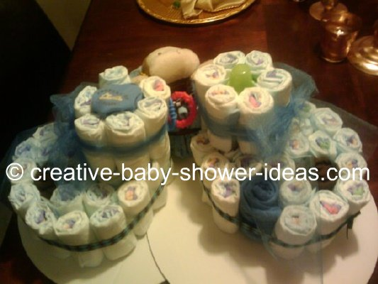 matching white and blue diaper bootie cakes