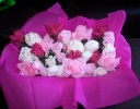 pink white and purple baby clothes bouquet