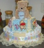 adorable soft winnie the pooh diaper cake with blankets toys and clothing from the show