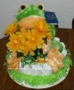 1 tier frog diaper cake with fun green hairy ribbon