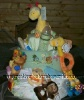 green and blue blanket covered diaper cake with jungle animals