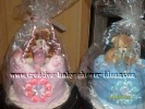 matching pink and blue twin diaper cakes with teddy bears on top