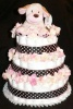 brown polka dot diaper cake with cream flowers and cream dog
