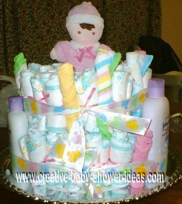 baby doll and washcloths diaper cake