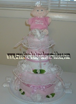 pink doll and lace diaper cake