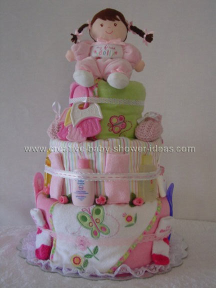 doll with brown braided hair on a diaper cake