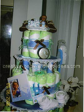 boy doll diaper cake with picture frame booties