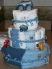 3 tier diaper cake with green and blue stripes and green rubber ducky