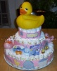 large 3 layer diaper cake with huge rubber ducky on top