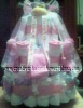 pink monkey diaper cake wrapped with white tulle