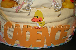 closeup of baby girl letters on diaper cake