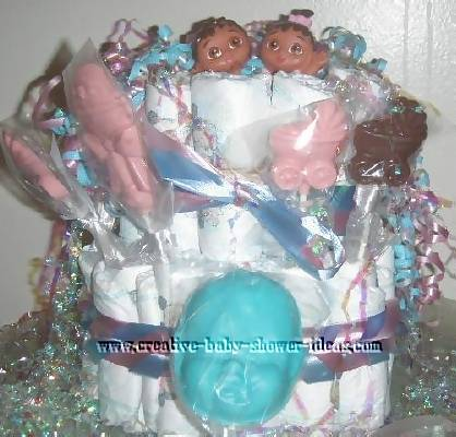 strawberry raspberry diaper cakes with suckers