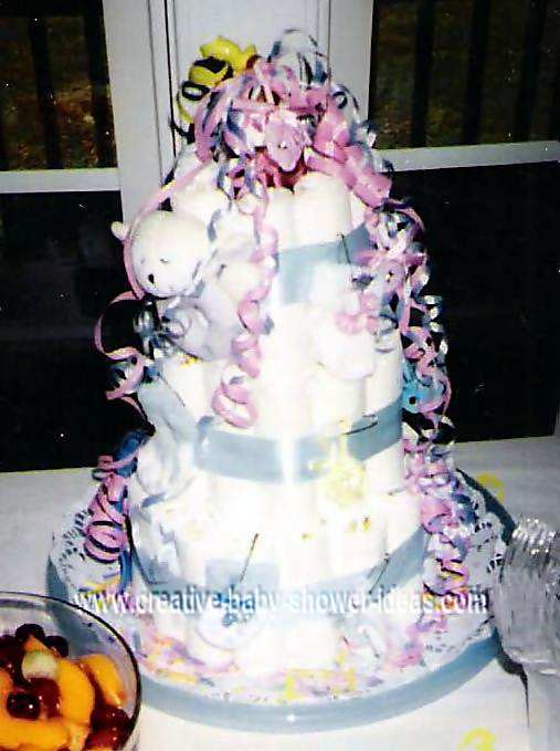 purple and white diaper cake