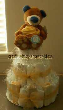 teddy bear with golden roses diaper cake
