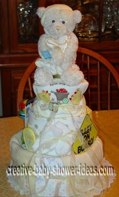 cream bear diaper cake with baby on board sign