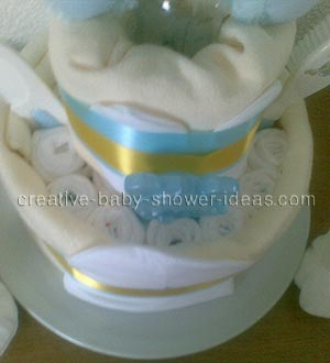 top of blue bear diaper cake