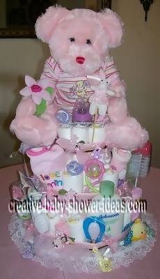 pink teddy bear and flower diaper cake