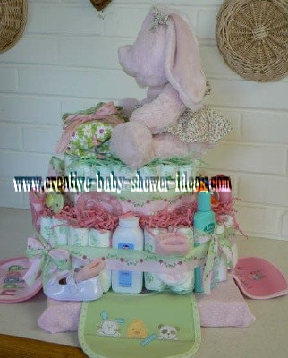 side of pink bunny diaper cake showing bibs