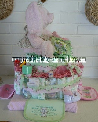 other side of pink bunny in cute floral dress on a diaper cake